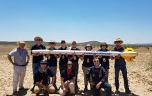 Rocket Team in the desert with their rocket