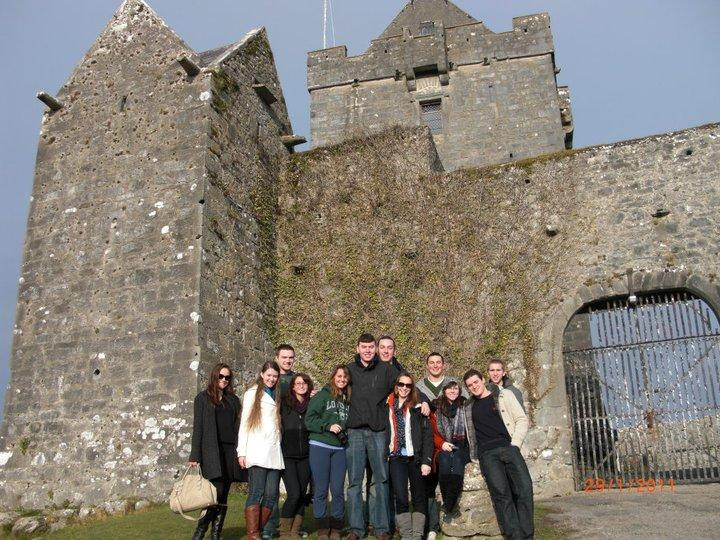 study abroad students in front of a castle in ireland