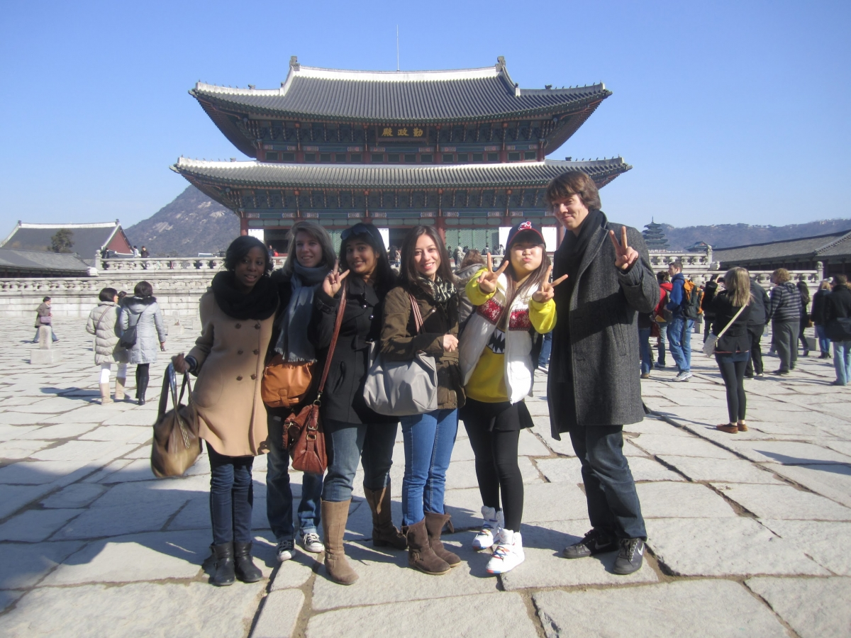 Study abroad students in South Korea posing in front of temple